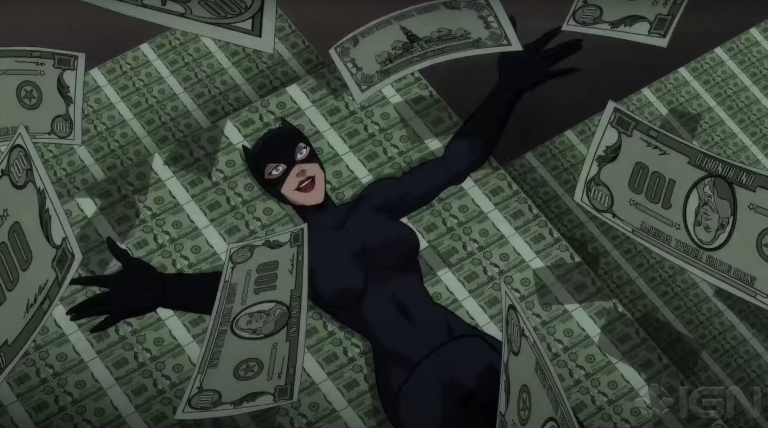 Catwoman lays in a pile of money