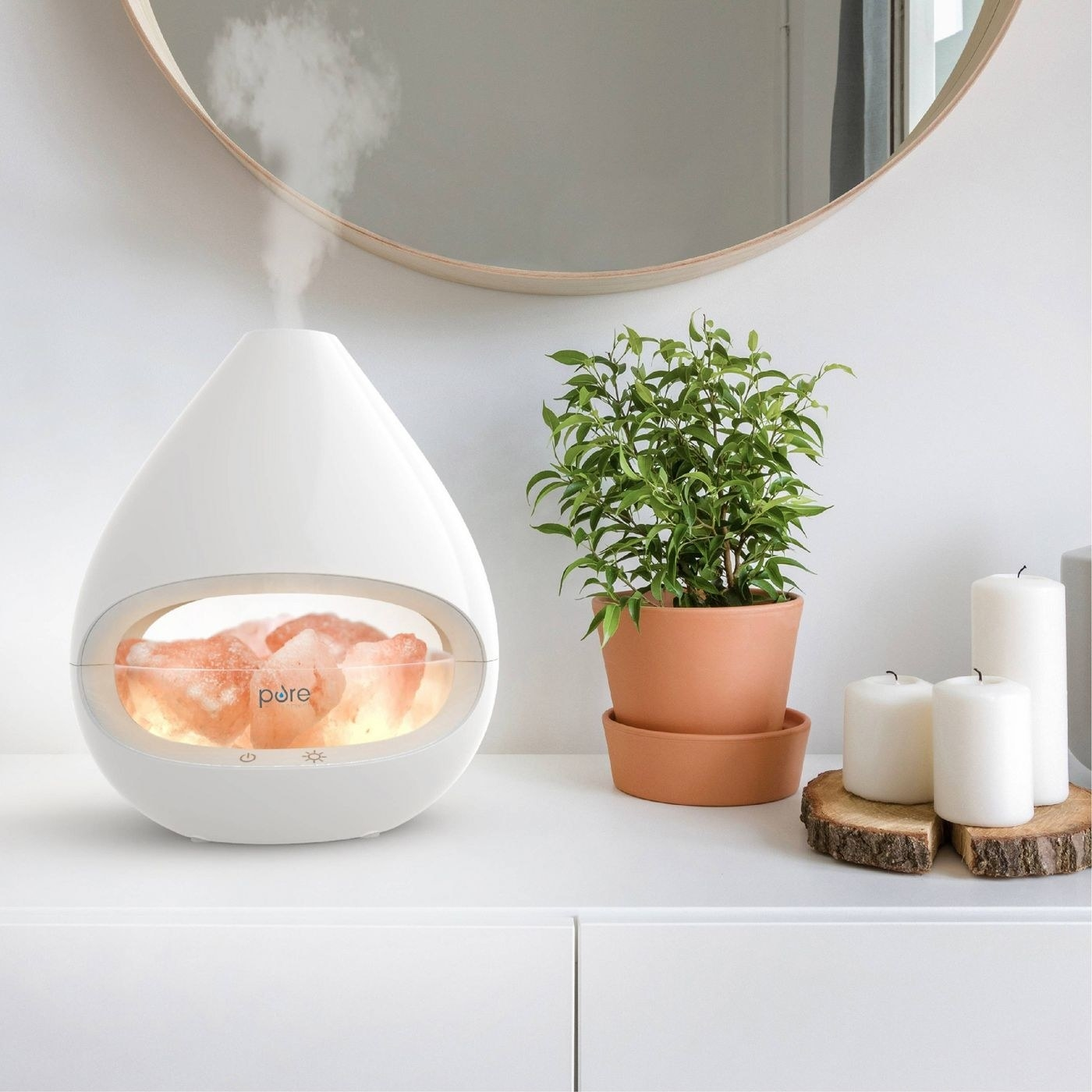 A white Himalayan salt lamp oil diffuser on a table