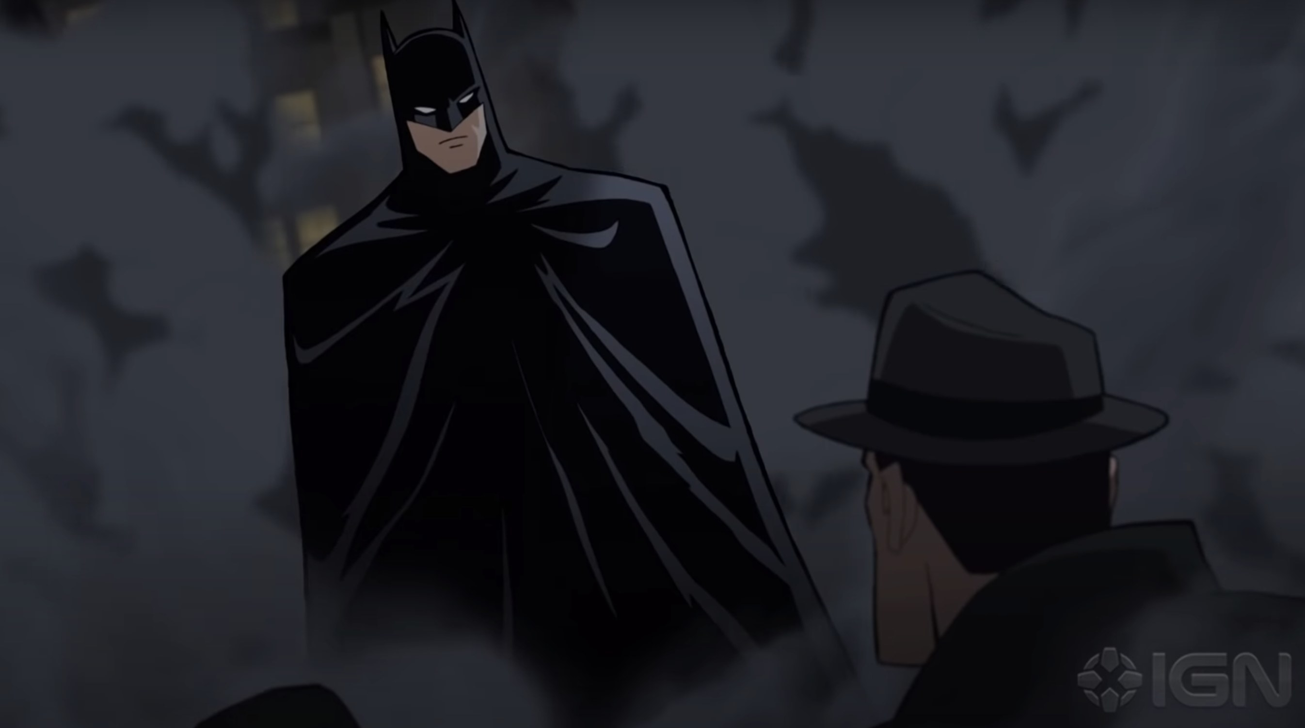 Batman stands in a cloud of dust in the movie