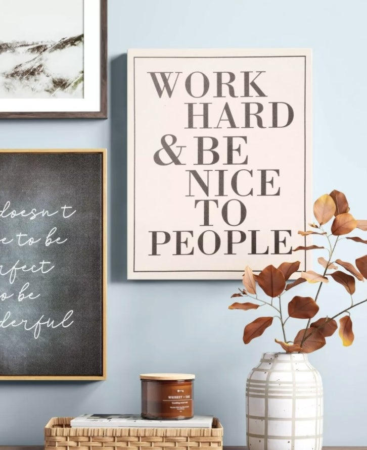 "The canvas reads, ""work hard and be nice to people"""