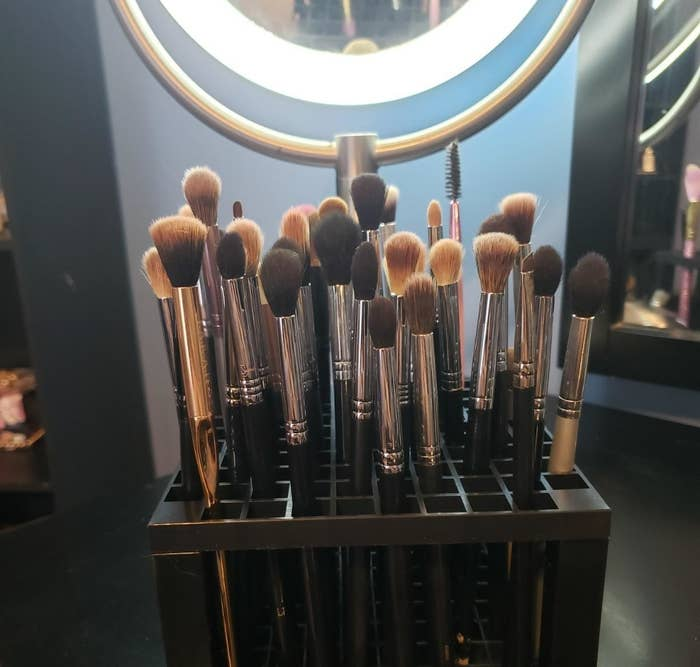 reviewer photo showing all their makeup brushes in the organizer