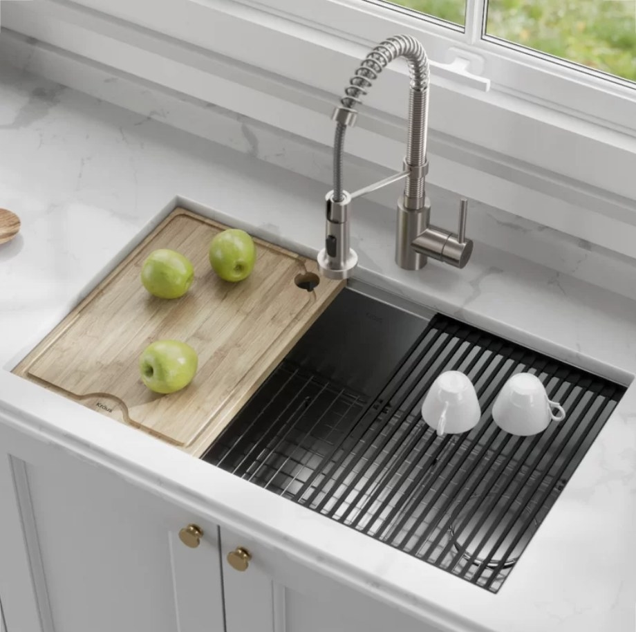 Cutting board and drying rack on kitchen sink