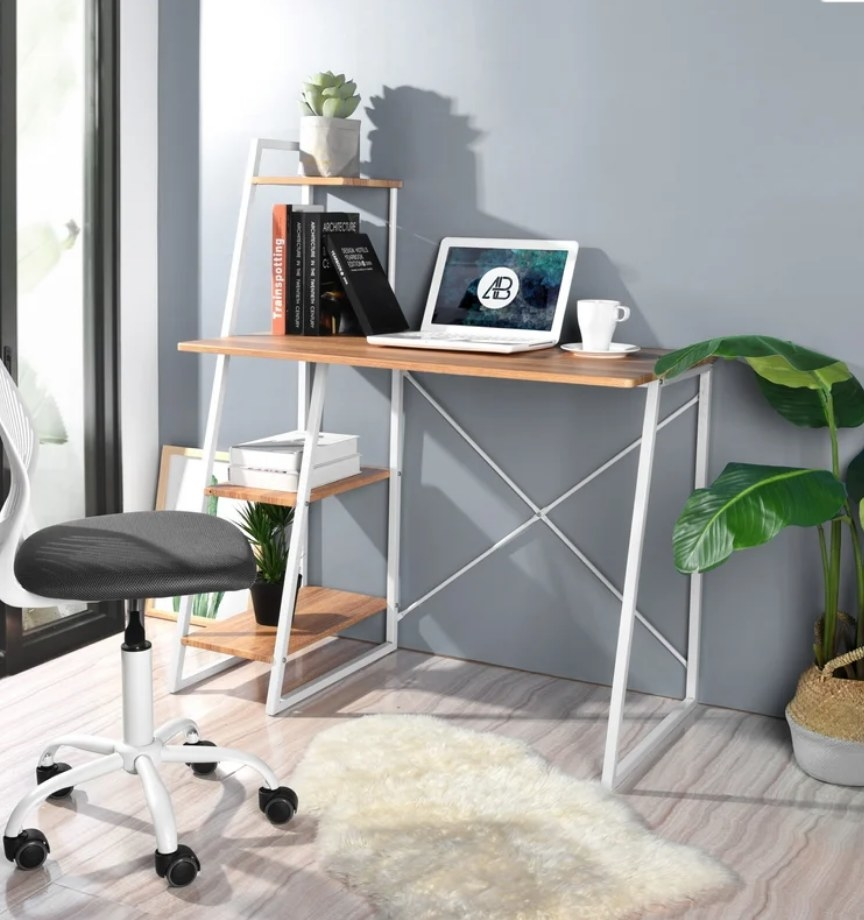 White metal frame desk with wooden tabletop and wooden shelving unit