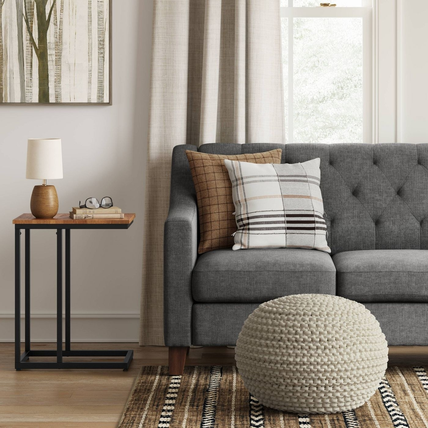 A chunky knit pouf in a living room
