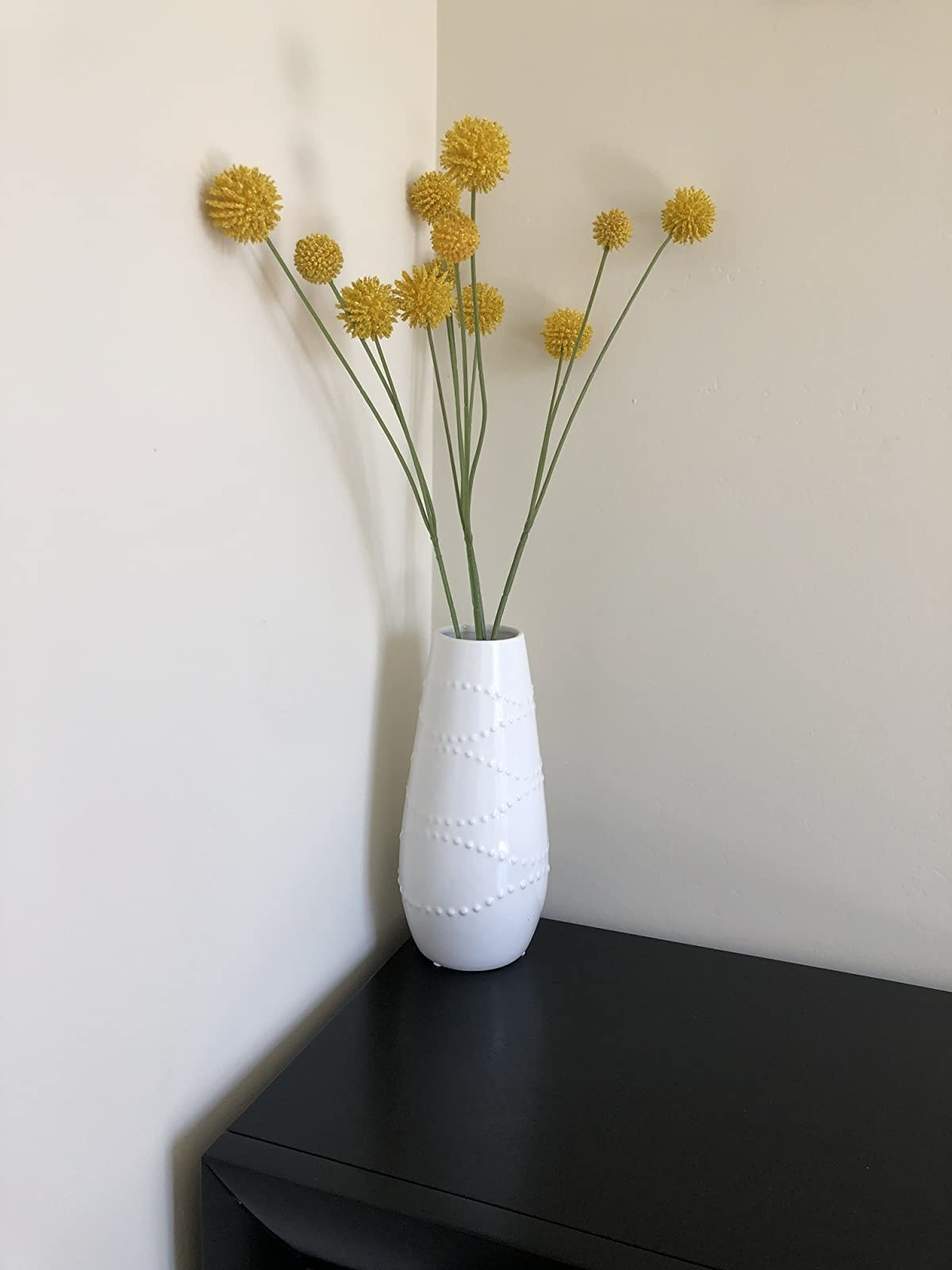 reviewer photo showing the vase with yellow flowers coming out of it