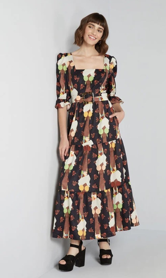 the dress on a model with black sandals