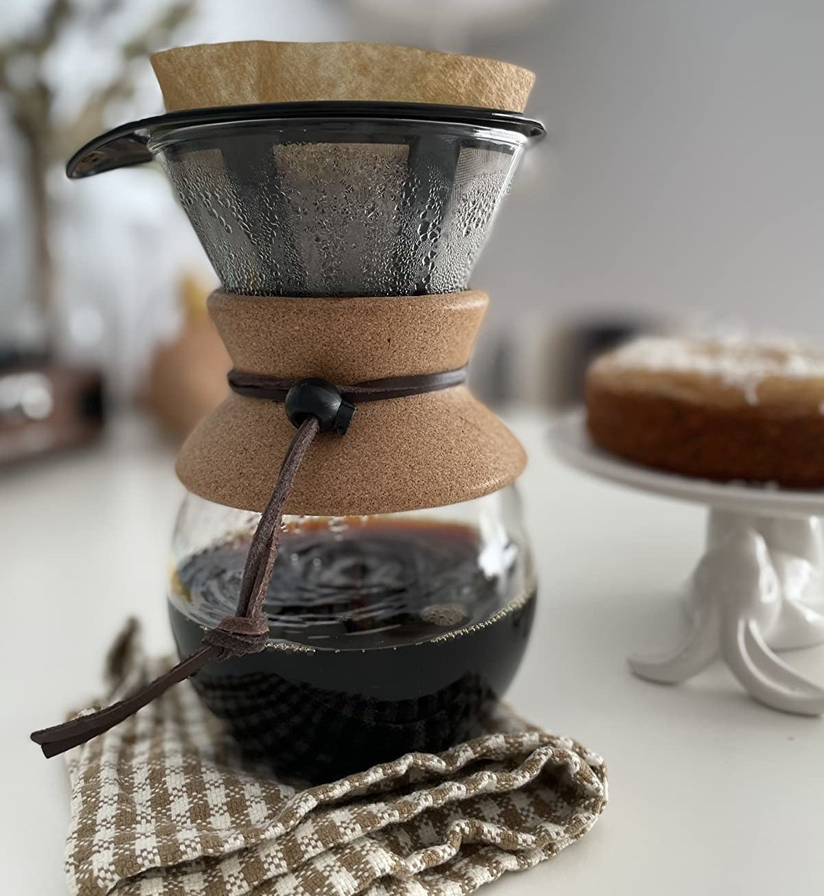 reviewer photo showing the pourover maker resting under a dishcloth