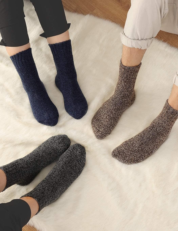 three models wearing the wool socks