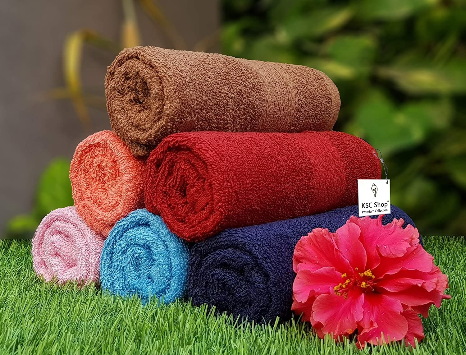 A set of cotton towels on grass