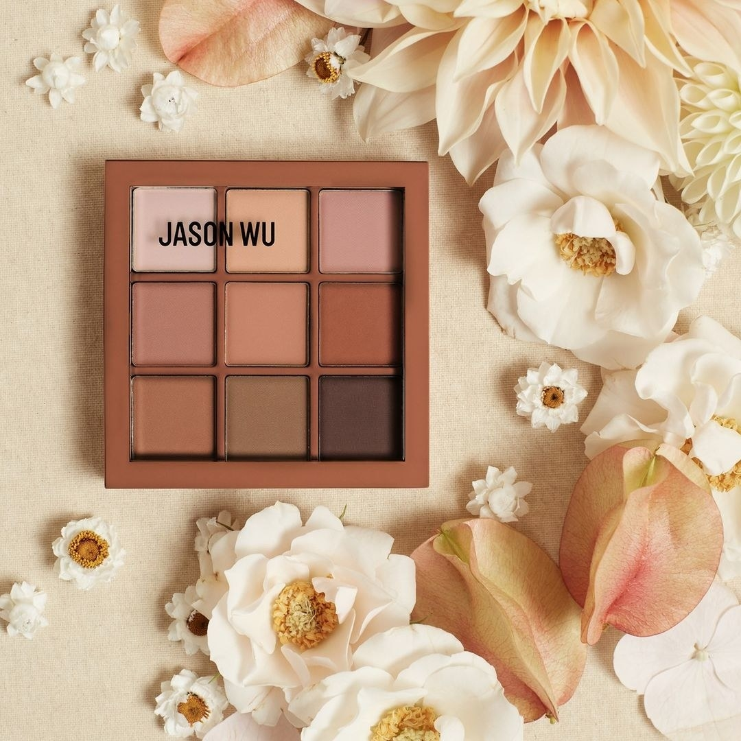 Jason Wu eyeshadow palette surrounded by flowers
