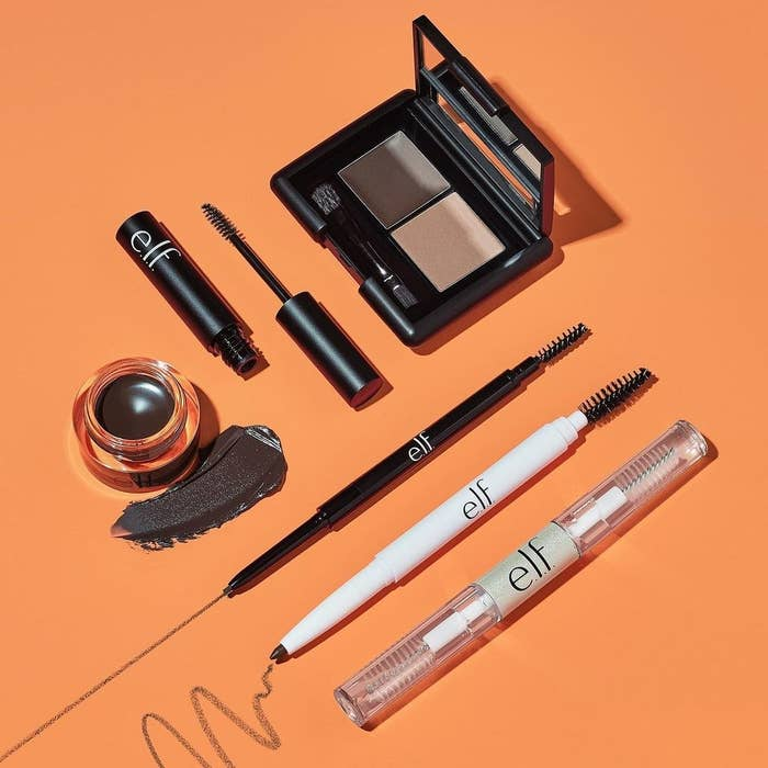 various e.l.f. makeup products against orange background