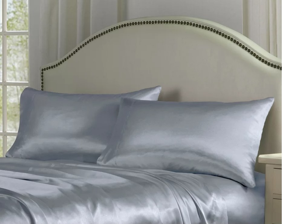 Gray satin sheets and pillows