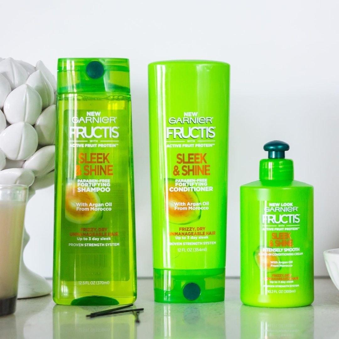 Three Garnier Fructis Sleek and Shine hair products