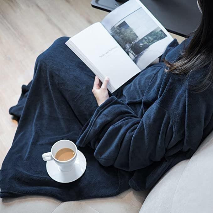 Navy blue fleece blanket with sleeves.