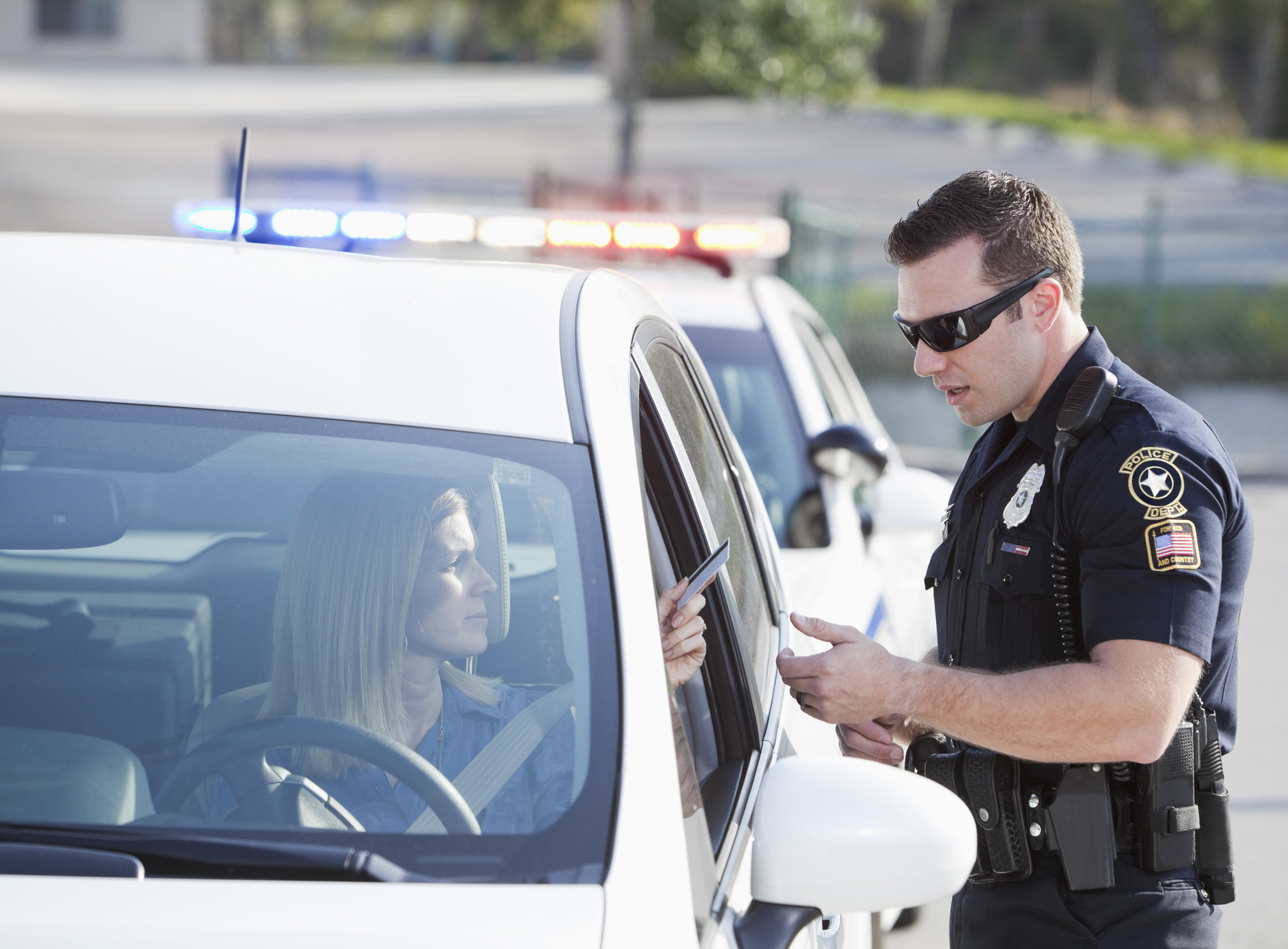 Police officer getting a driver's information