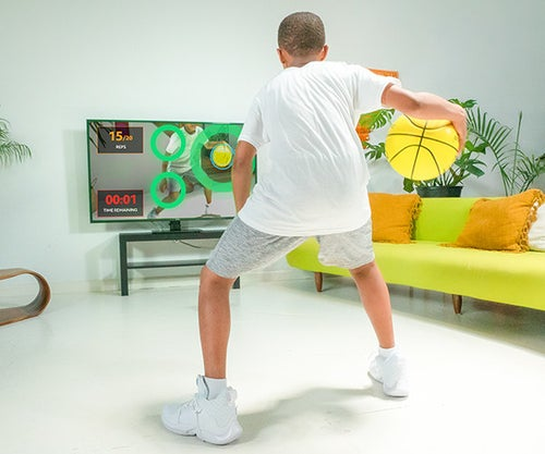 Model uses the basketball and a smart TV to do a training session