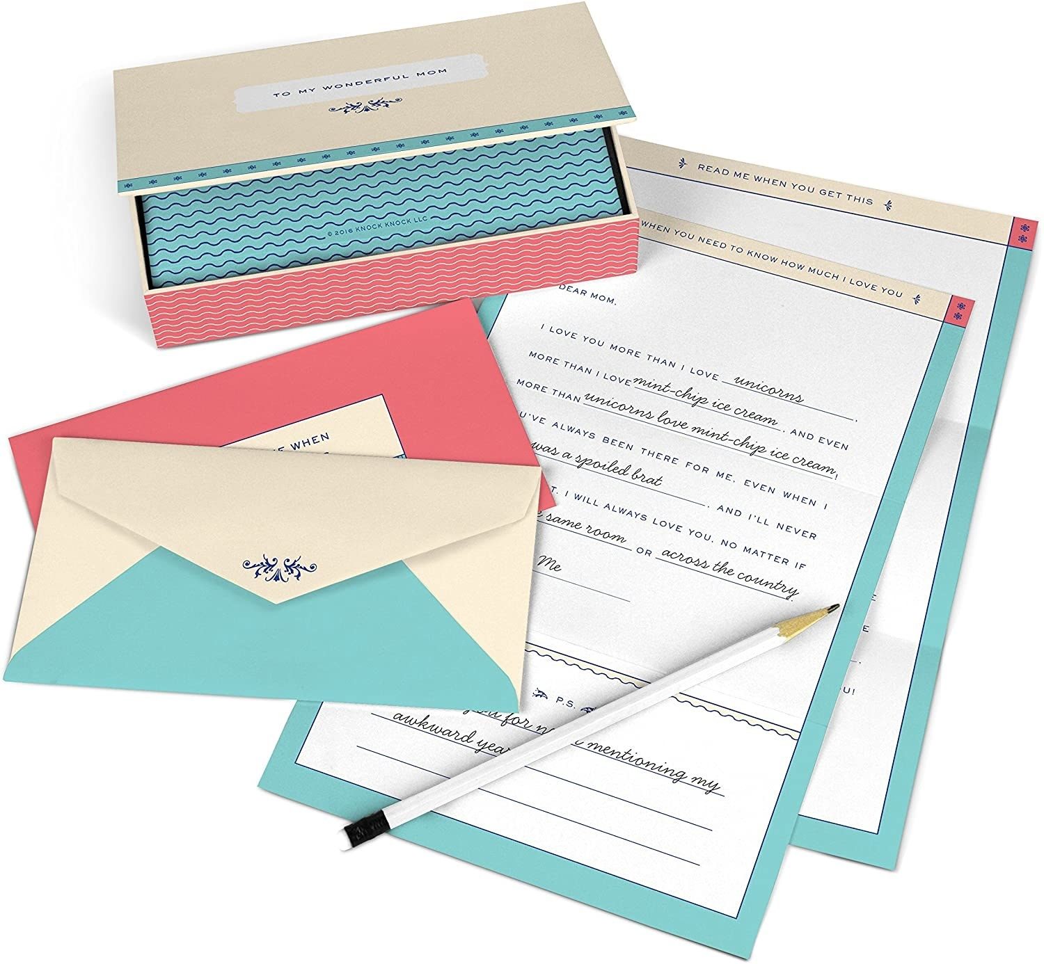 the fill in the blank letters and pretty mint, cream, and coral envelopes