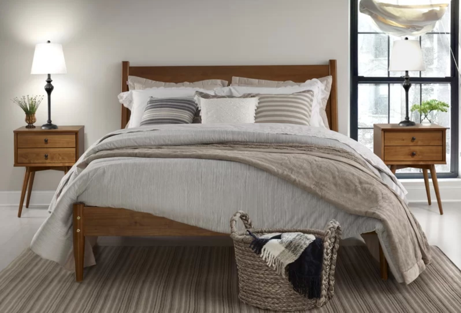 The midcentury platform bed with a solid light wood headboard