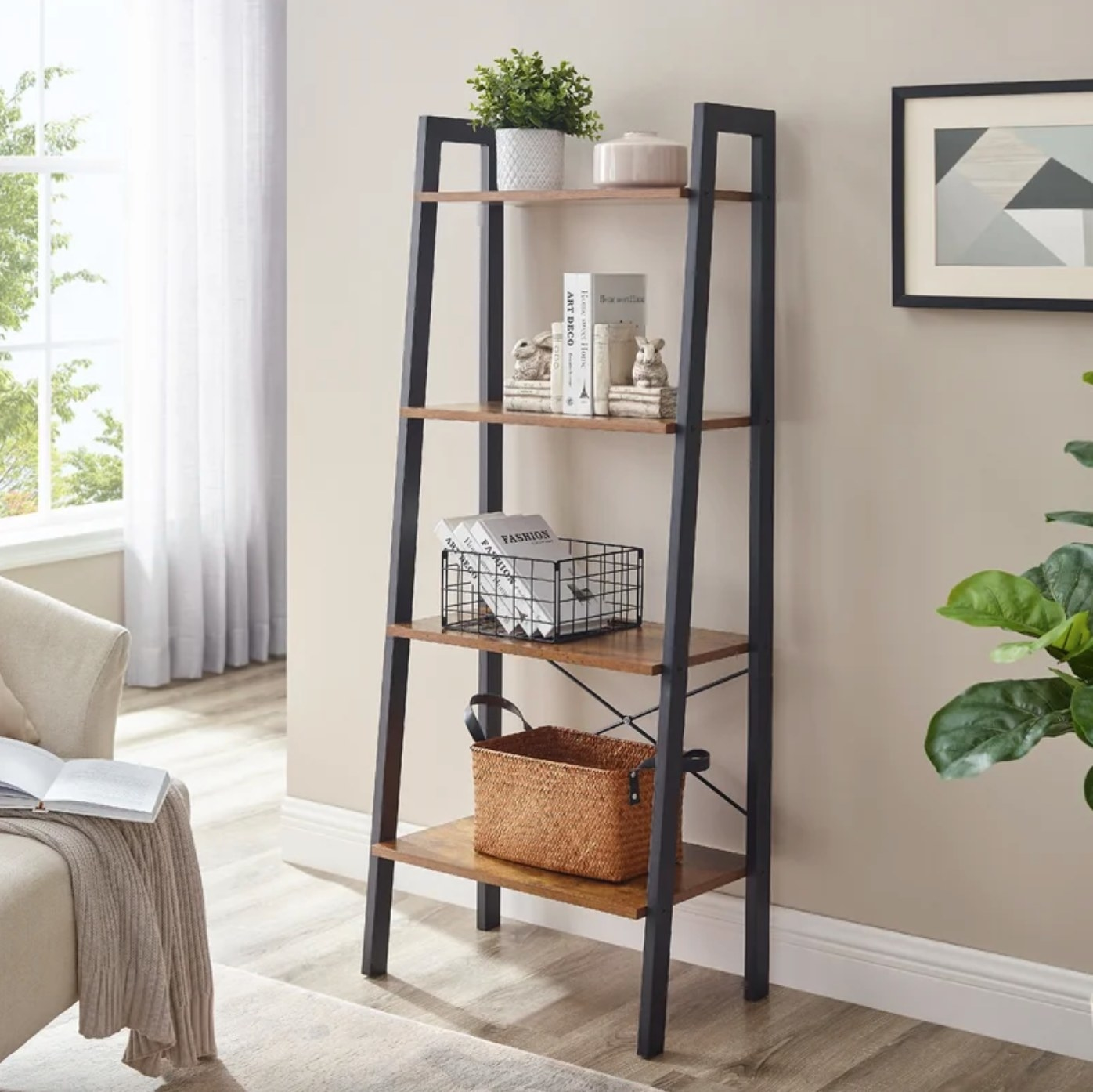 The steel bookcase with wood shelves holding a basket of books and a plant