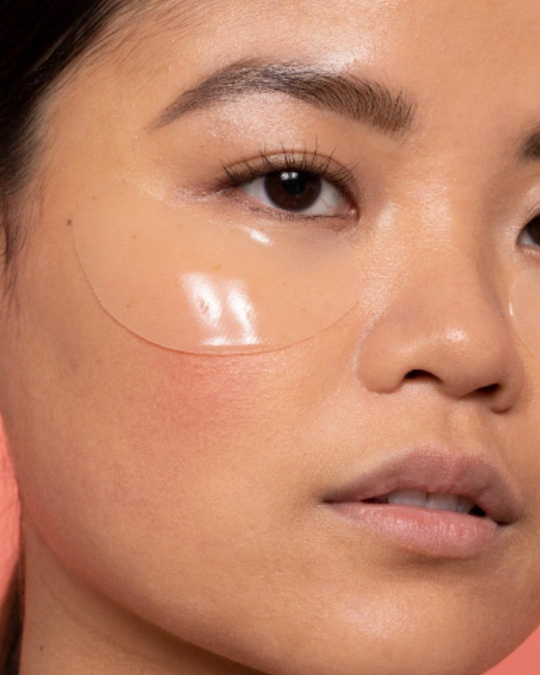 A close up of one of the hydrogel eye masks on a person's face