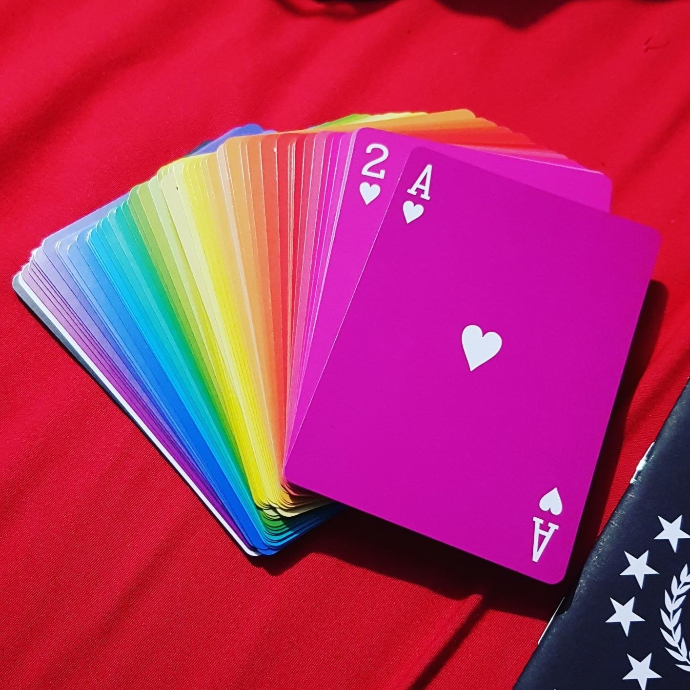 reviewer's stack of rainbow colored cards
