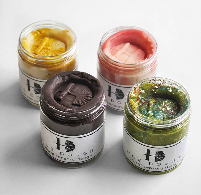 A set of four jars of sensory dough, each in a different colour