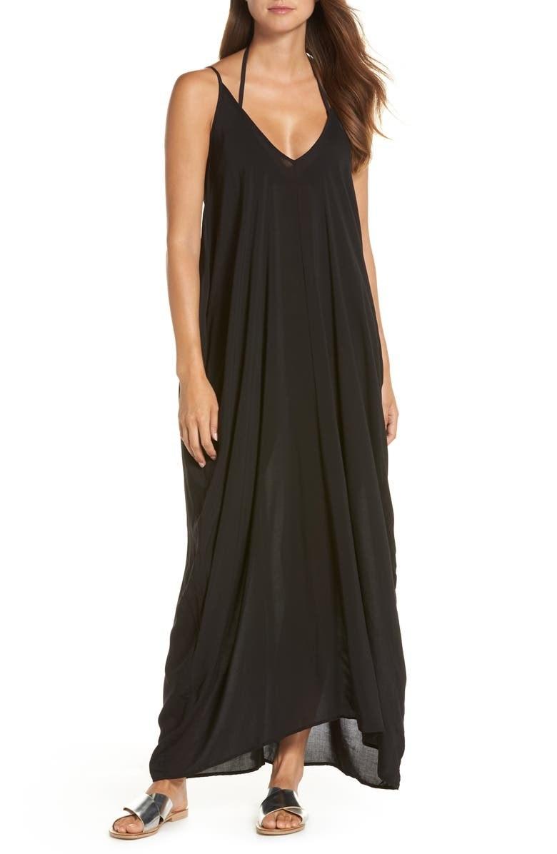 A model wears the black maxi dress