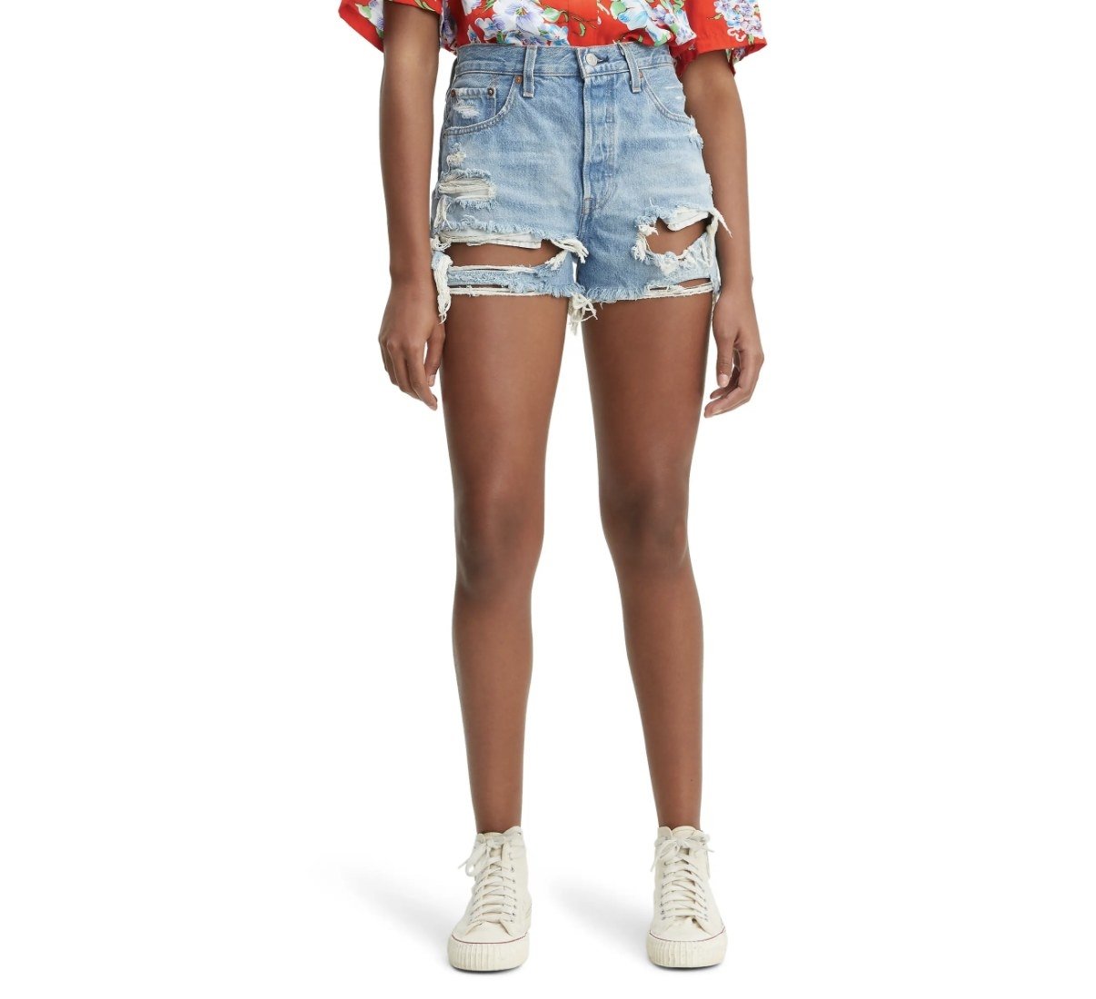 Model is wearing blue high-waisted shorts and tennis shoes