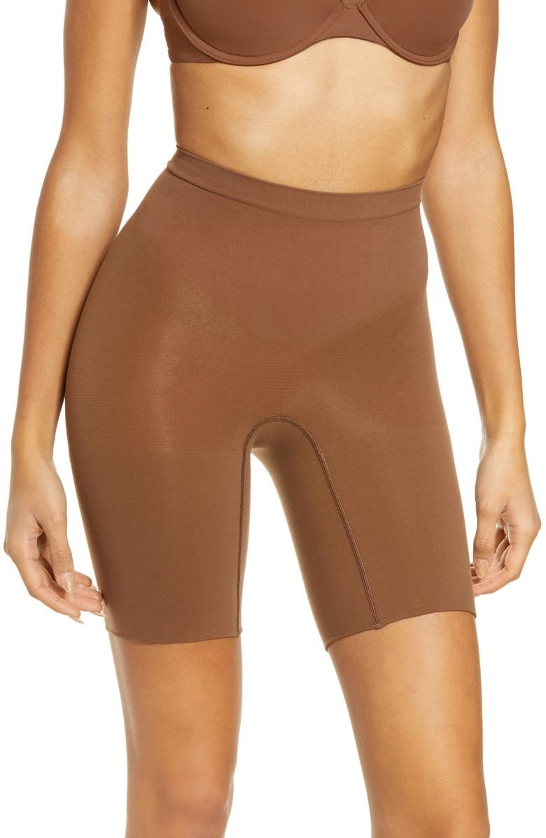 A model wears the shorts in Chestnut Brown