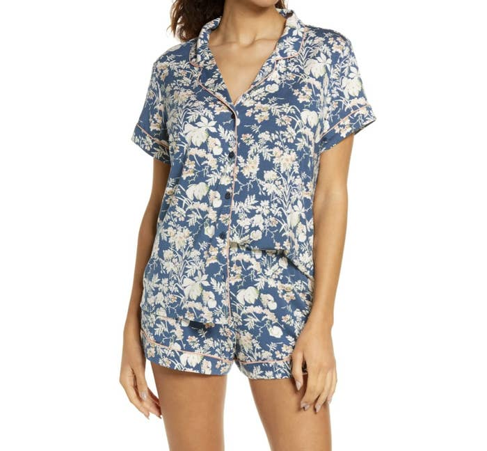 Model is wearing a blue and white floral pajama set