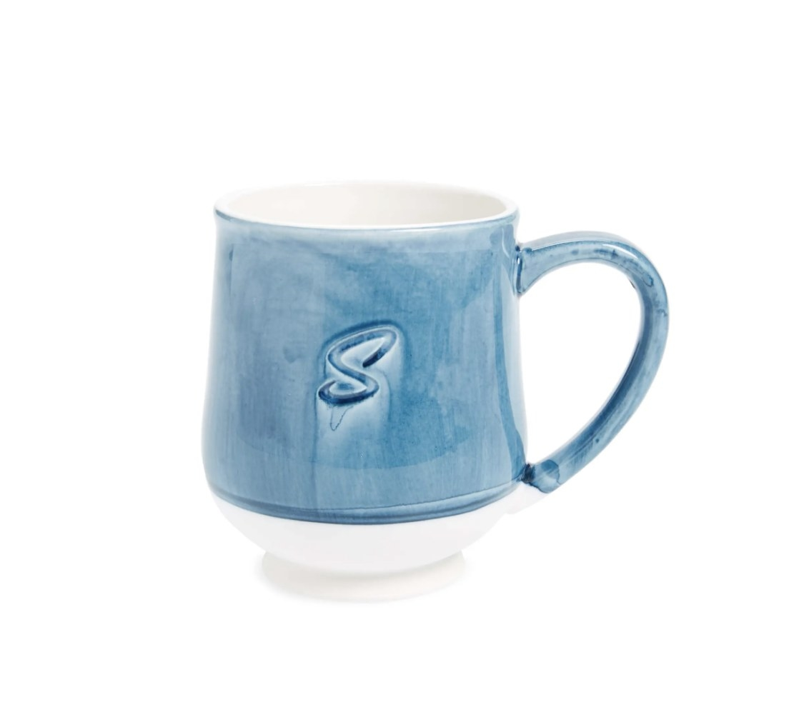 A blue mug with the letter S on it
