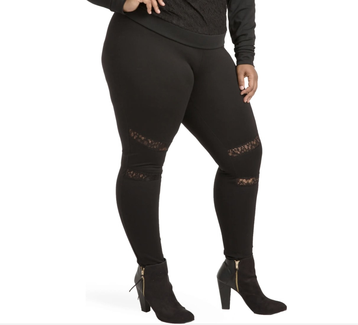 Model is wearing black leggings and black booties