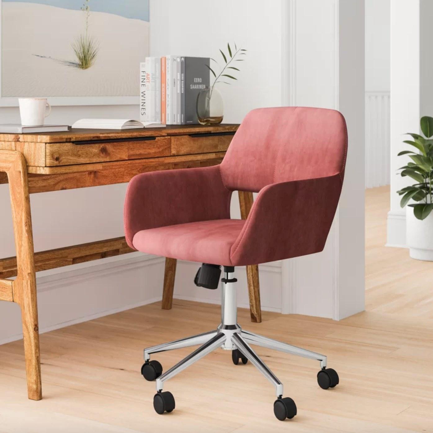 The velvet task chair with rose upholstery and chrome legs