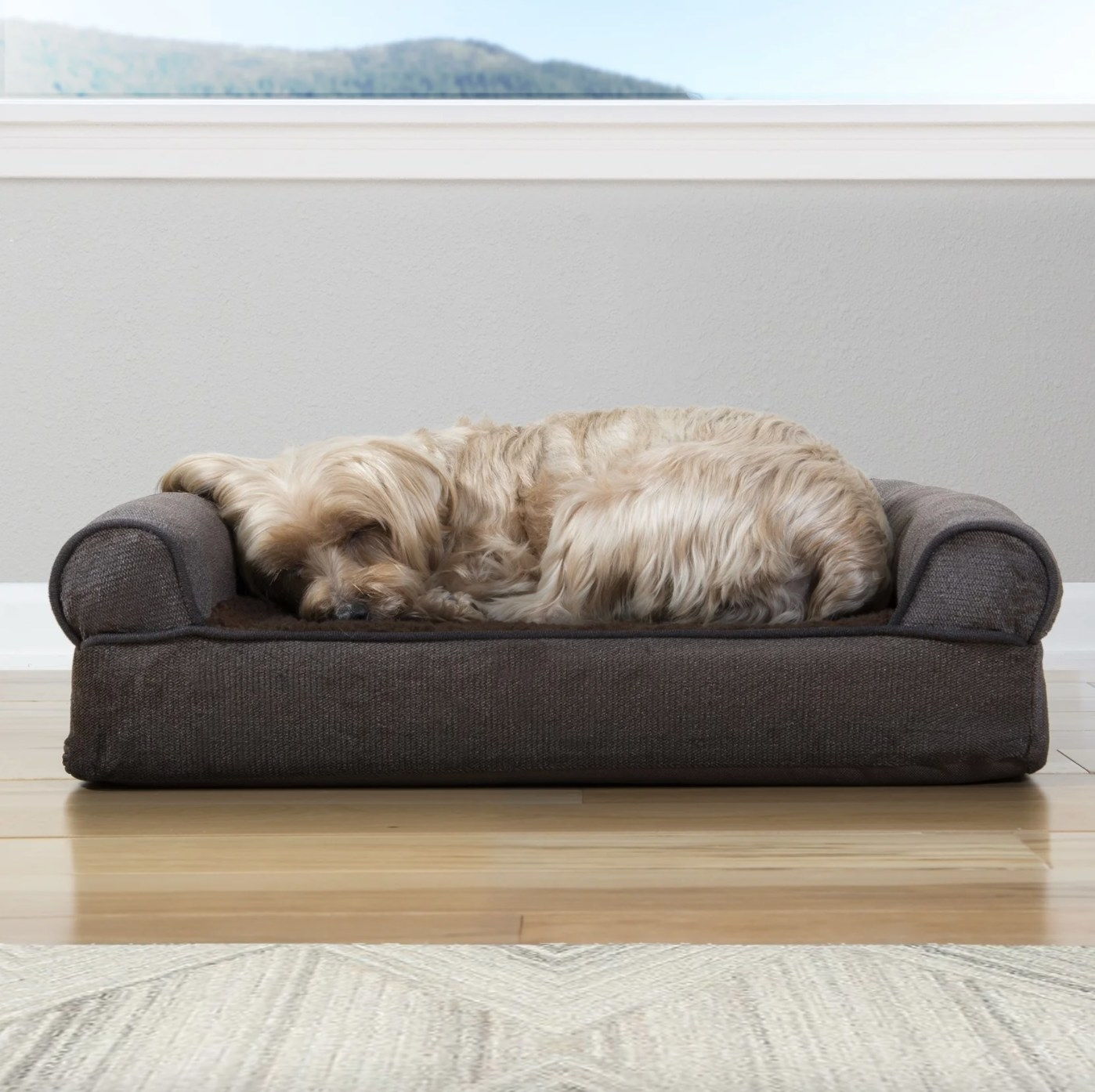 Dog sleeping on the dog bed that has corduroy-like fabric
