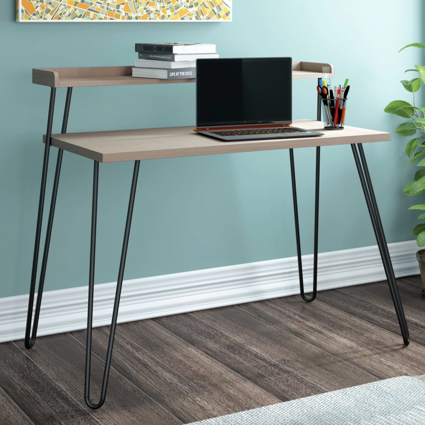 The two-tier wood desk with metal hairpin legs in sonoma oak/ black