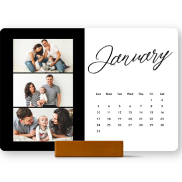 a horizontal January calendar page with three family photos on the side