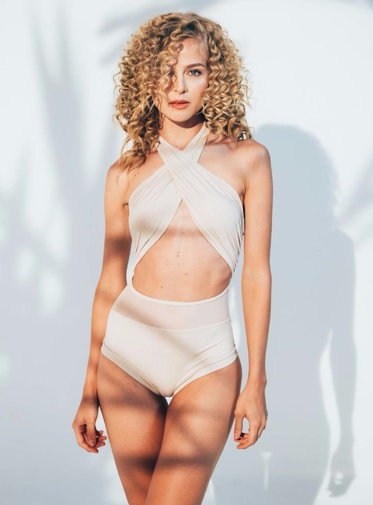 A model wearing the Alayna Maillot one piece in Glow