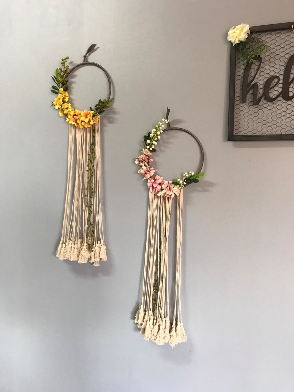 Reviewer photo of floral dreamcatchers hanging on wall