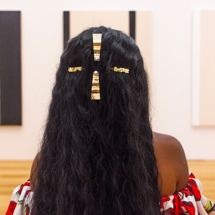 model wearing several of the barrettes in their hair