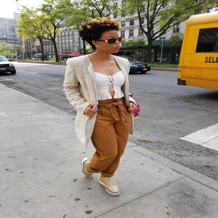 reviewer wears apricot platform oxfords with mustard tie-waist pants, a cami, and a white blazer jacket
