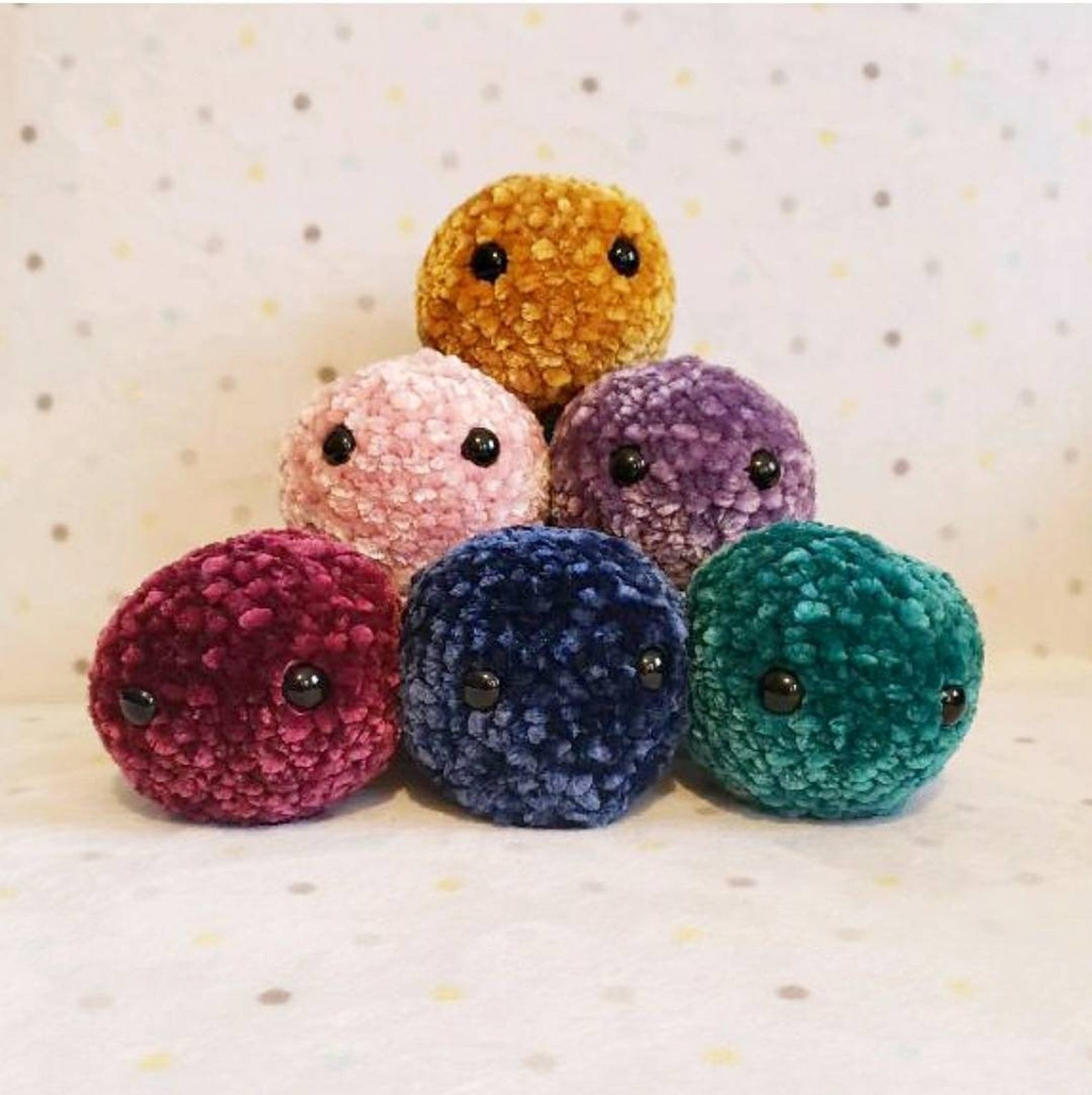 Round velvety balls in different colors with black beads for eyes