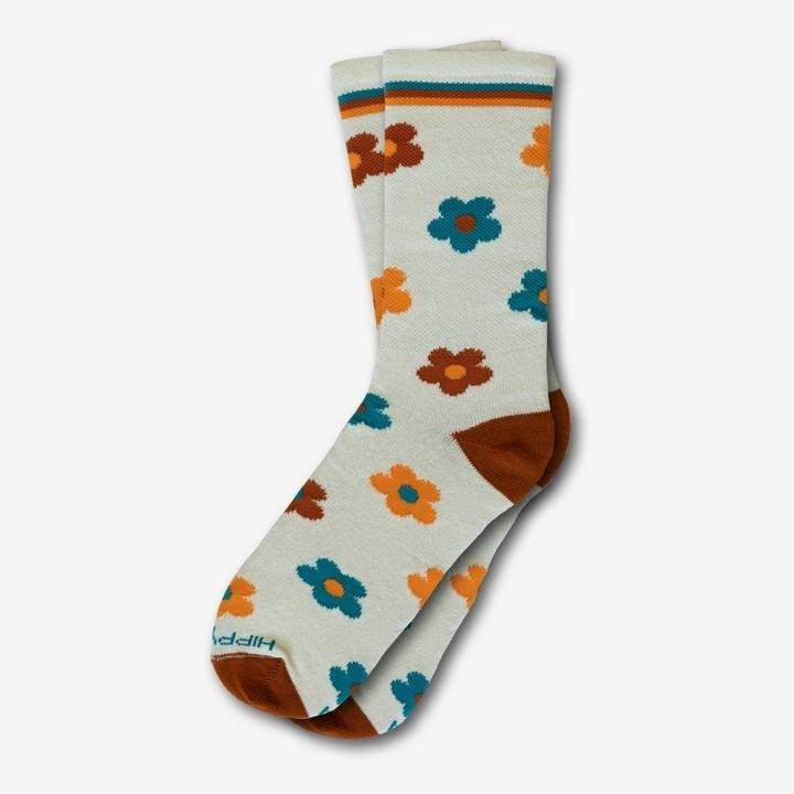 cream socks printed with orange, teal, and red flowers