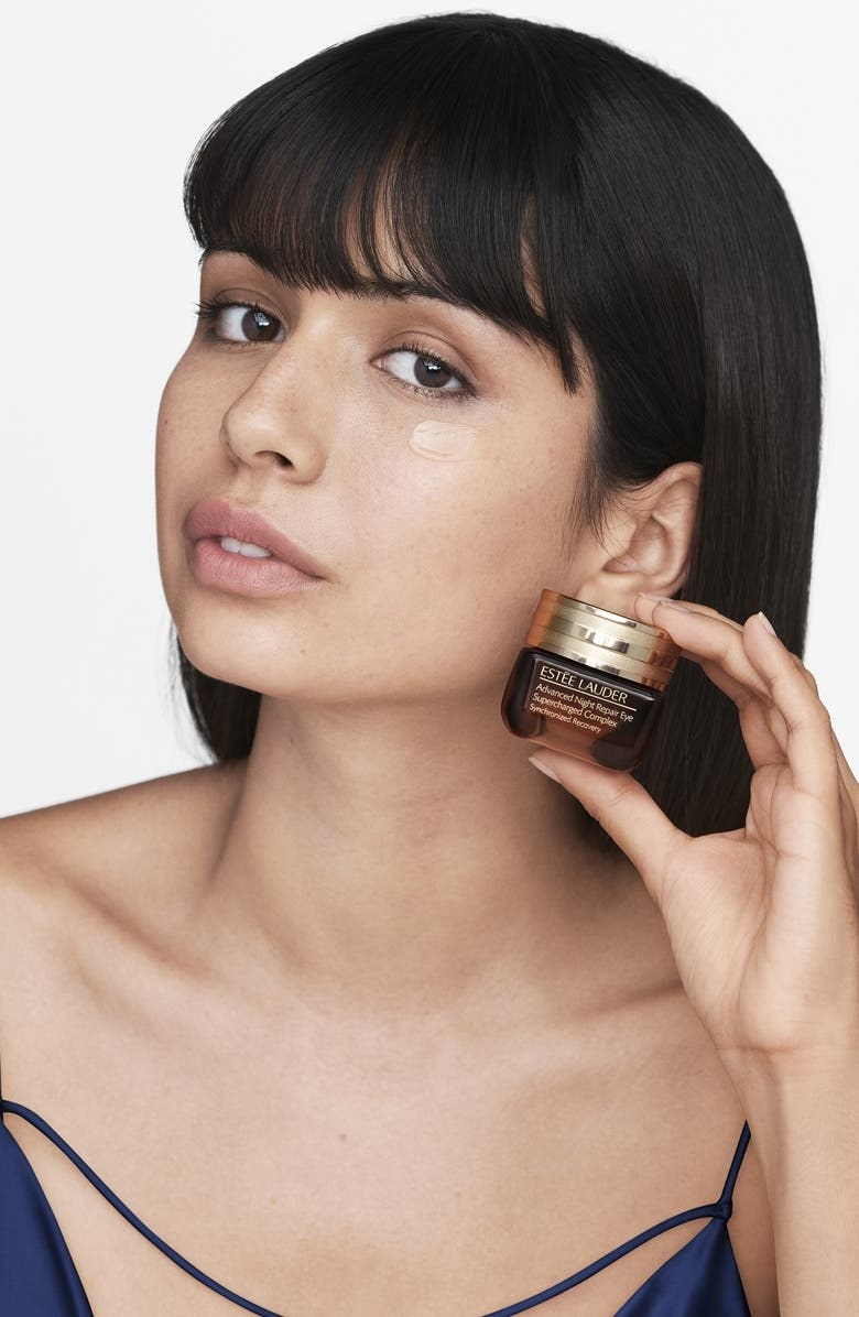 A model with the product on their face holds the product