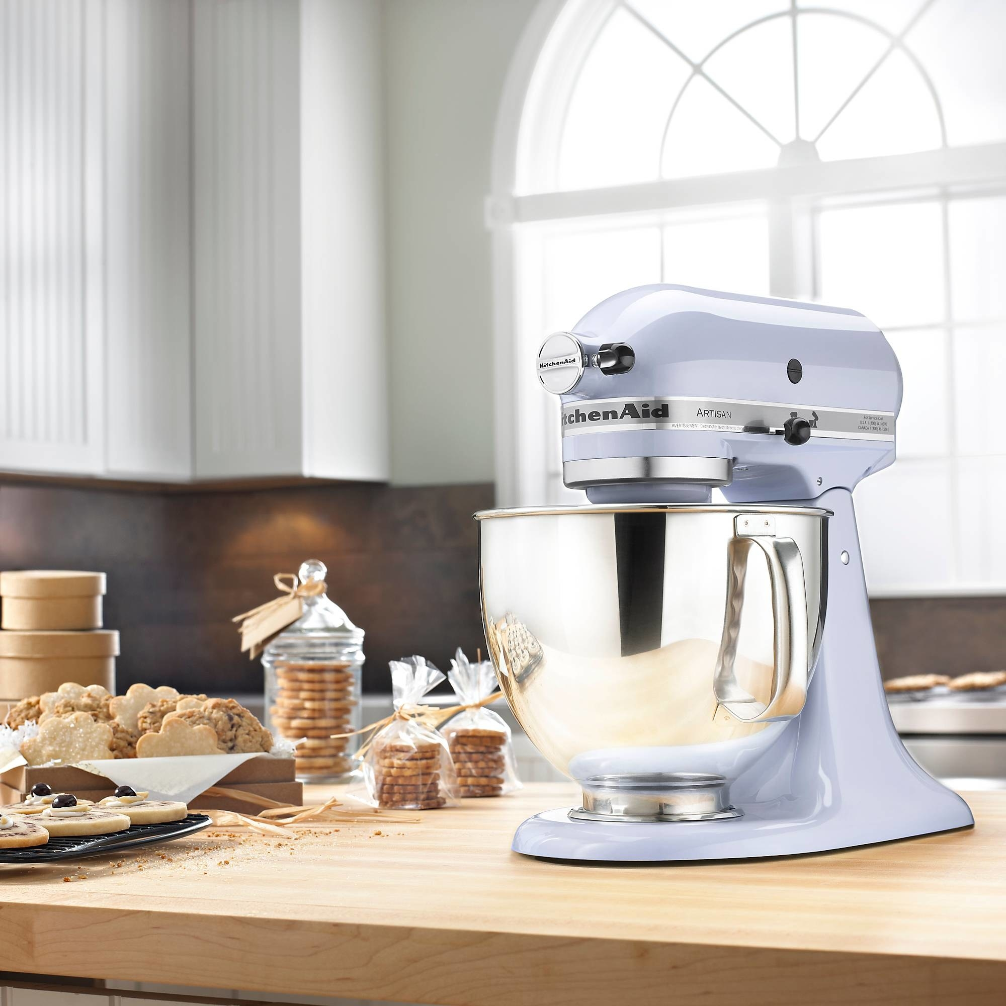 the stand mixer in light blue with large silver bowl on a counter