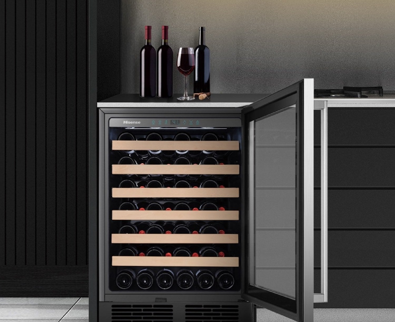 the mini fridge-shaped wine cooler with six tan shelves holding a variety of wine bottles