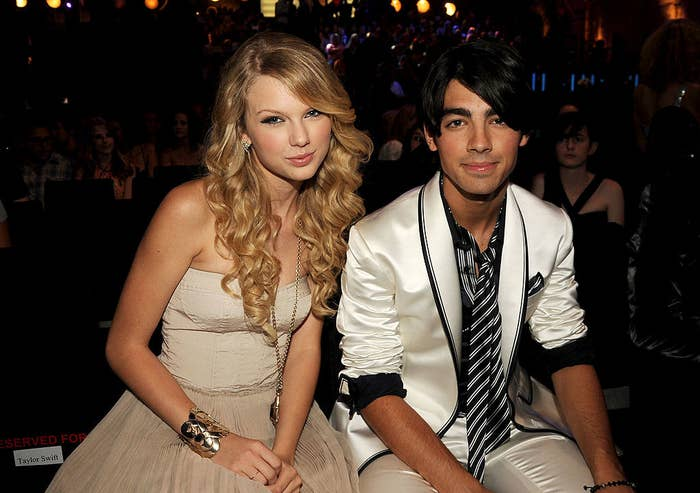 Taylor and Joe sitting together at an awards show