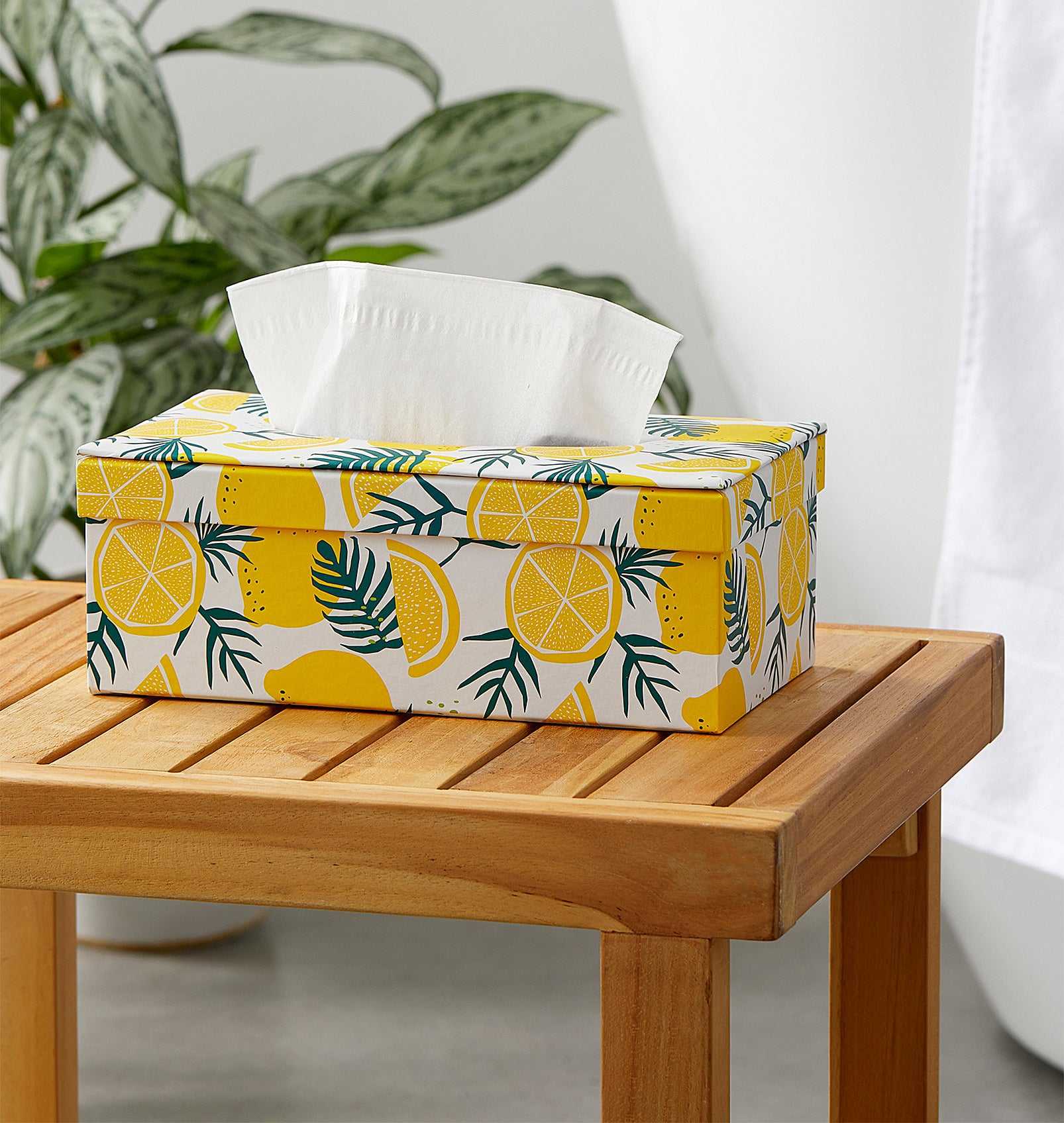 A lemon-print tissue box holder