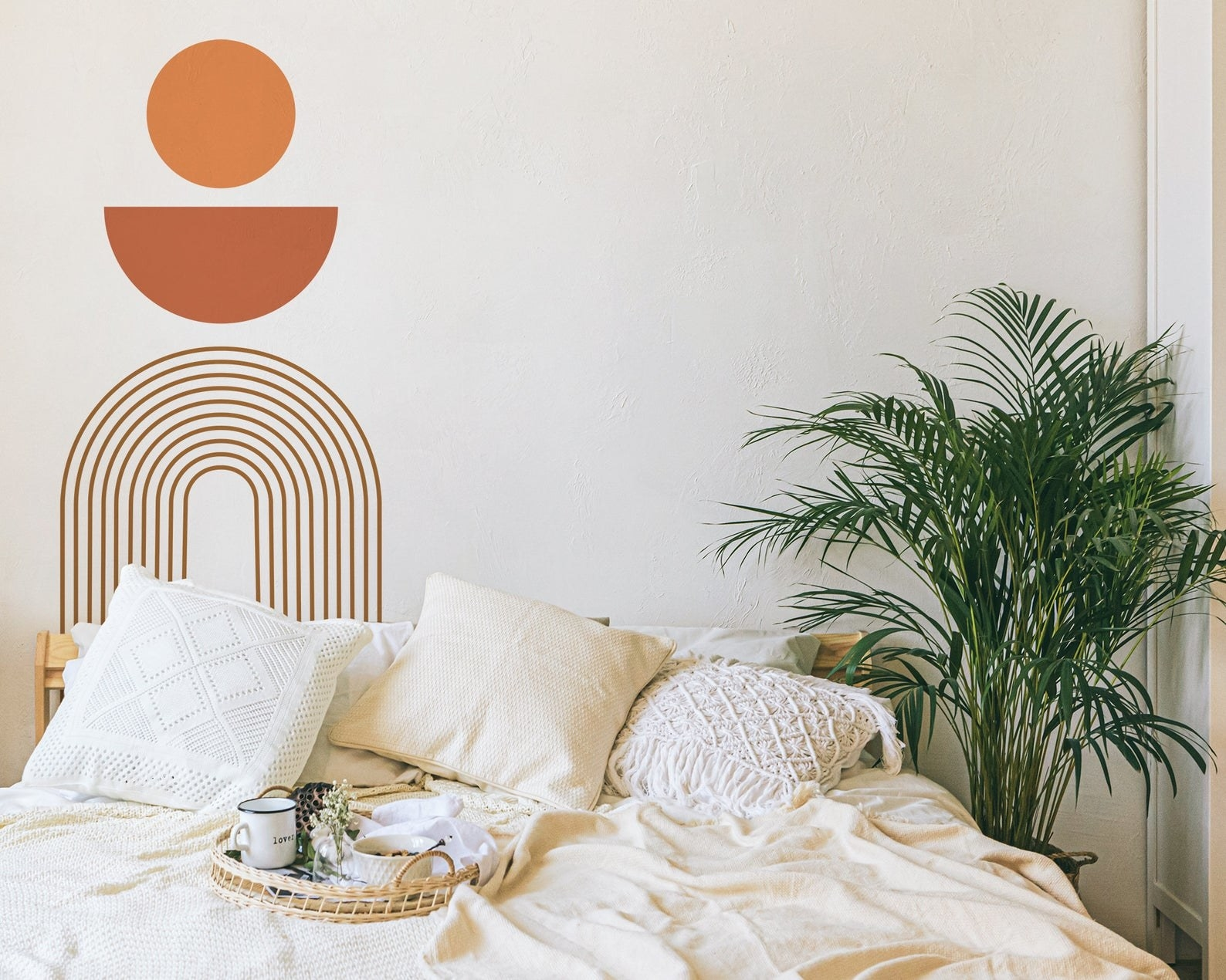 the wall decal behind a bed