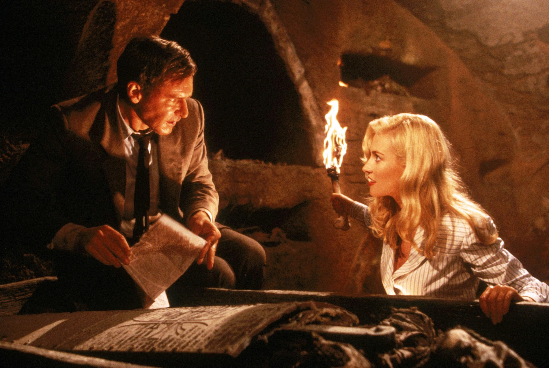 Indiana Jones deciphering ancient text