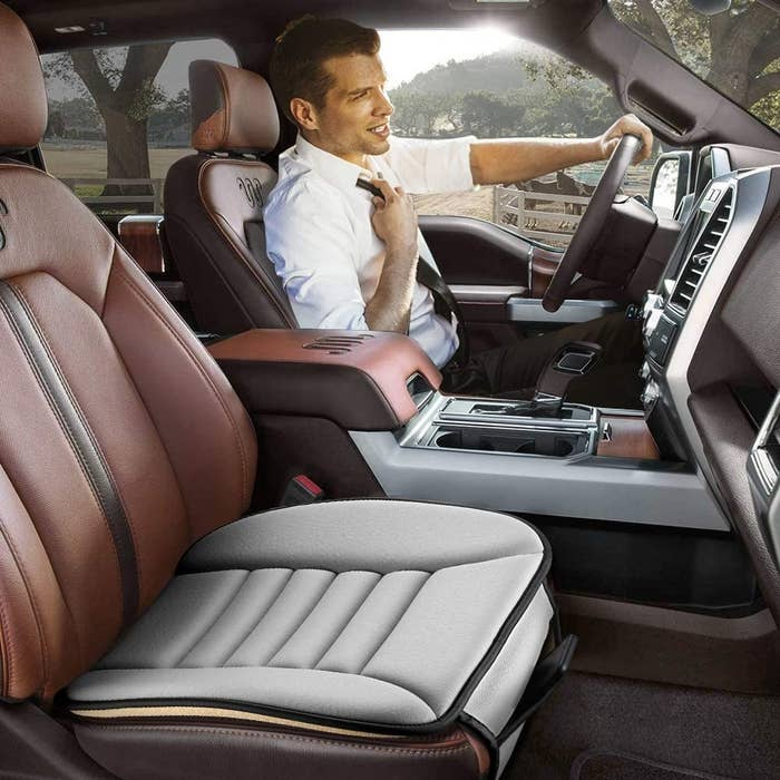 person driving in a car with the memory foam seat in the passenger seat